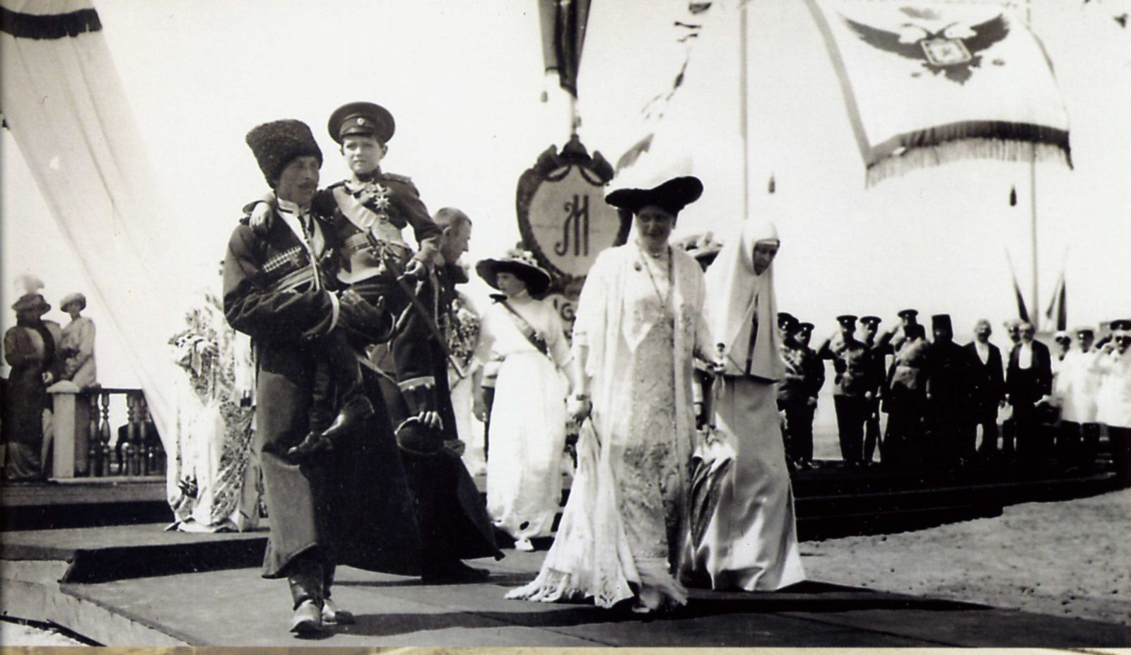 Empress Alexandra Feodorovna, Grand Duchess Elisaveta Feodorovna and Tsarevich Alexei Nikolayevich (in the hands of uncle) during the celebration of the 300th anniversary of the Romanov Imperial House. 1913 year.