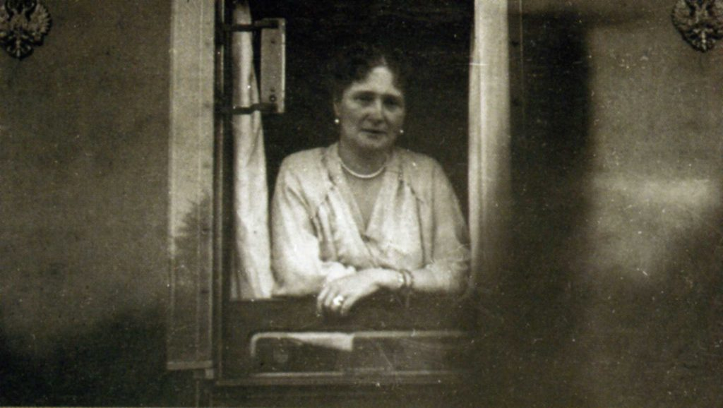 Empress Alexandra Feodorovna in the window of the train car.
