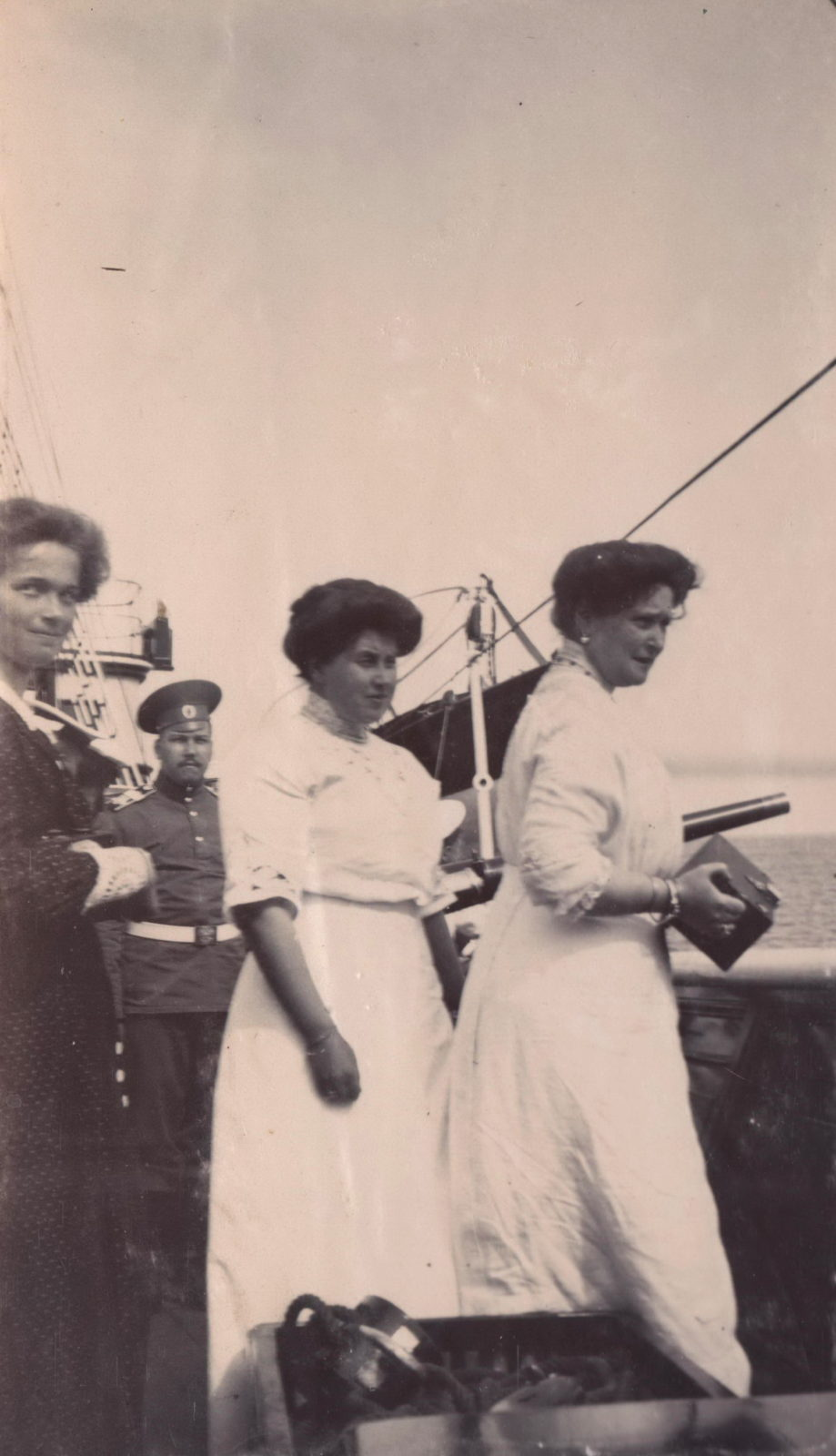 Empress Alexandra Feodorovna with a camera in her hands.