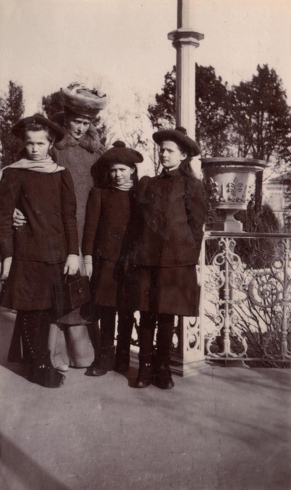 Empress Alexandra Feodorovna with her daughters on a walk.