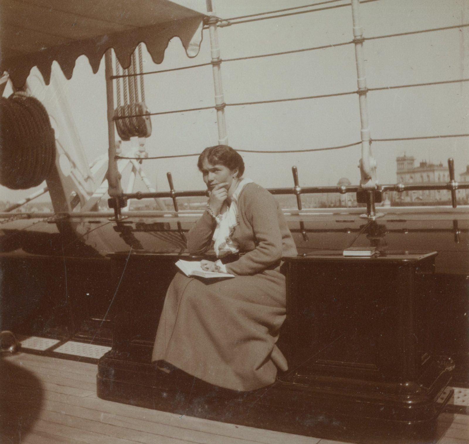 "Grand Princess Olga Nikolayevna reading a book on board the Imperial yacht ""Standart""."