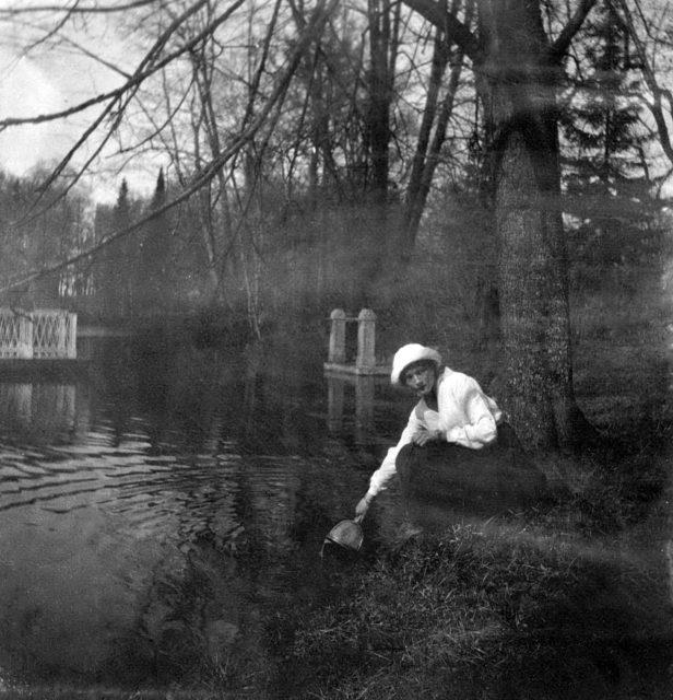 Grand Princess Tatiana Nikolayevna on the shore of the pond.
