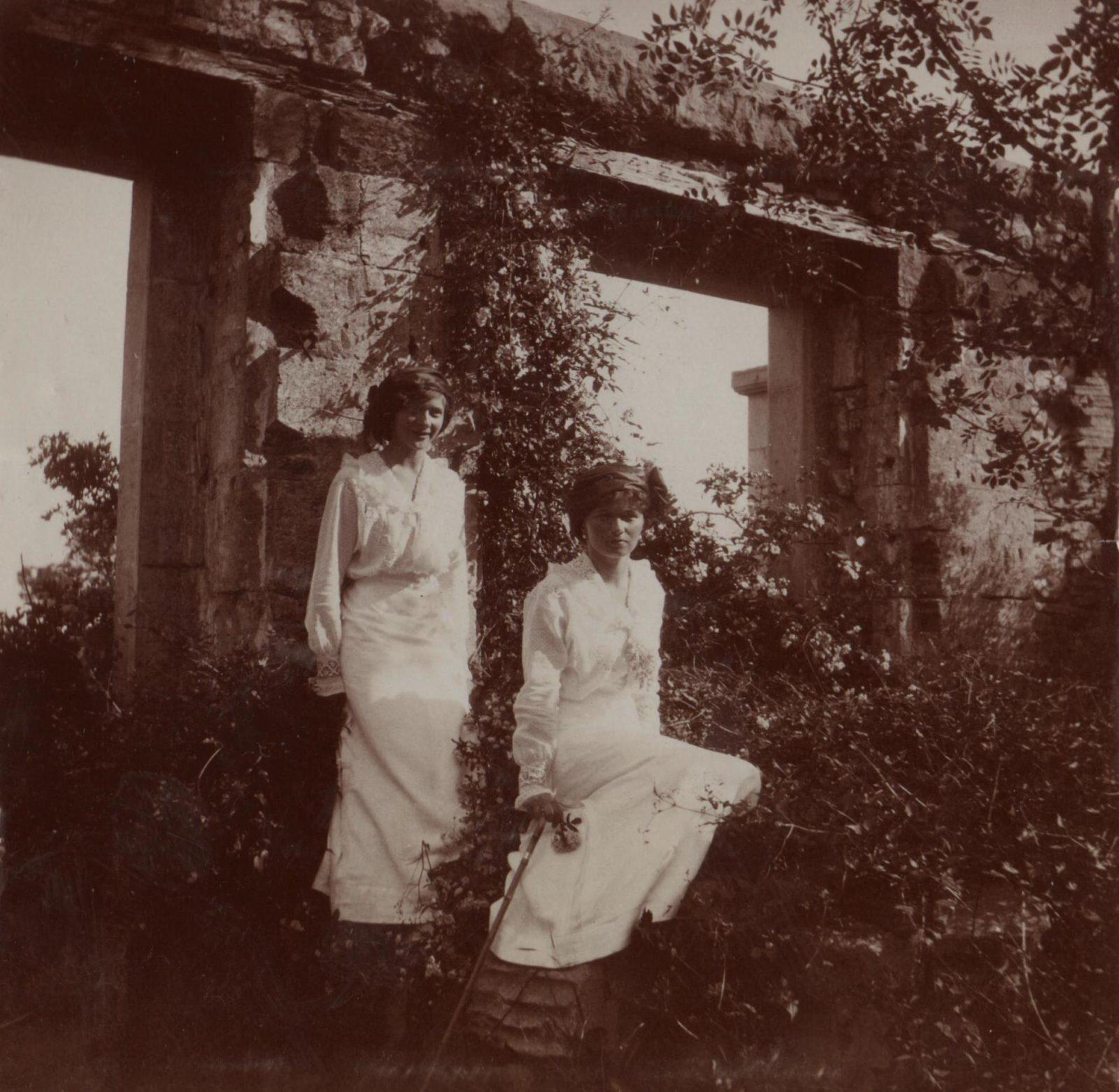 Grand Princesses Olga Nikolaevna (sits) and Tatyana Nikolayevna on a walk.
