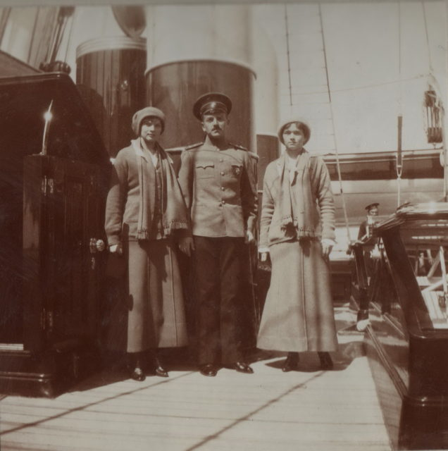 "Grand Princesses Olga Nikolayevna and Tatyana Nikolaevna with midshipman Pavel Voronov aboard the Imperial yacht ""Standart""."