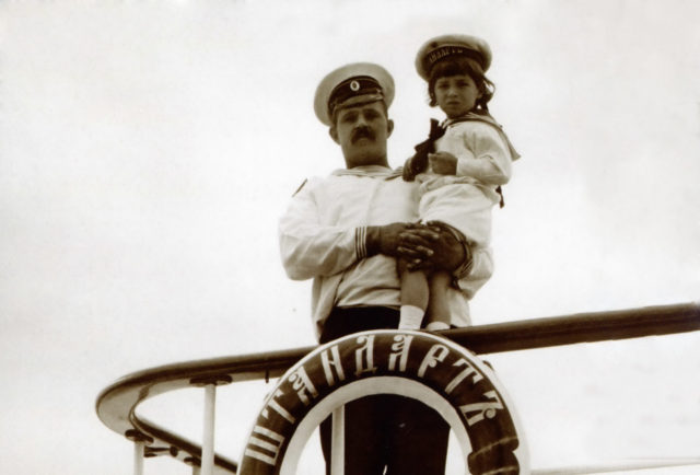 His Imperial Highness The heir to the Russian throne Tsesarevich Alexei Nikolayevich in the hands of the boatswain Dereven'ko.