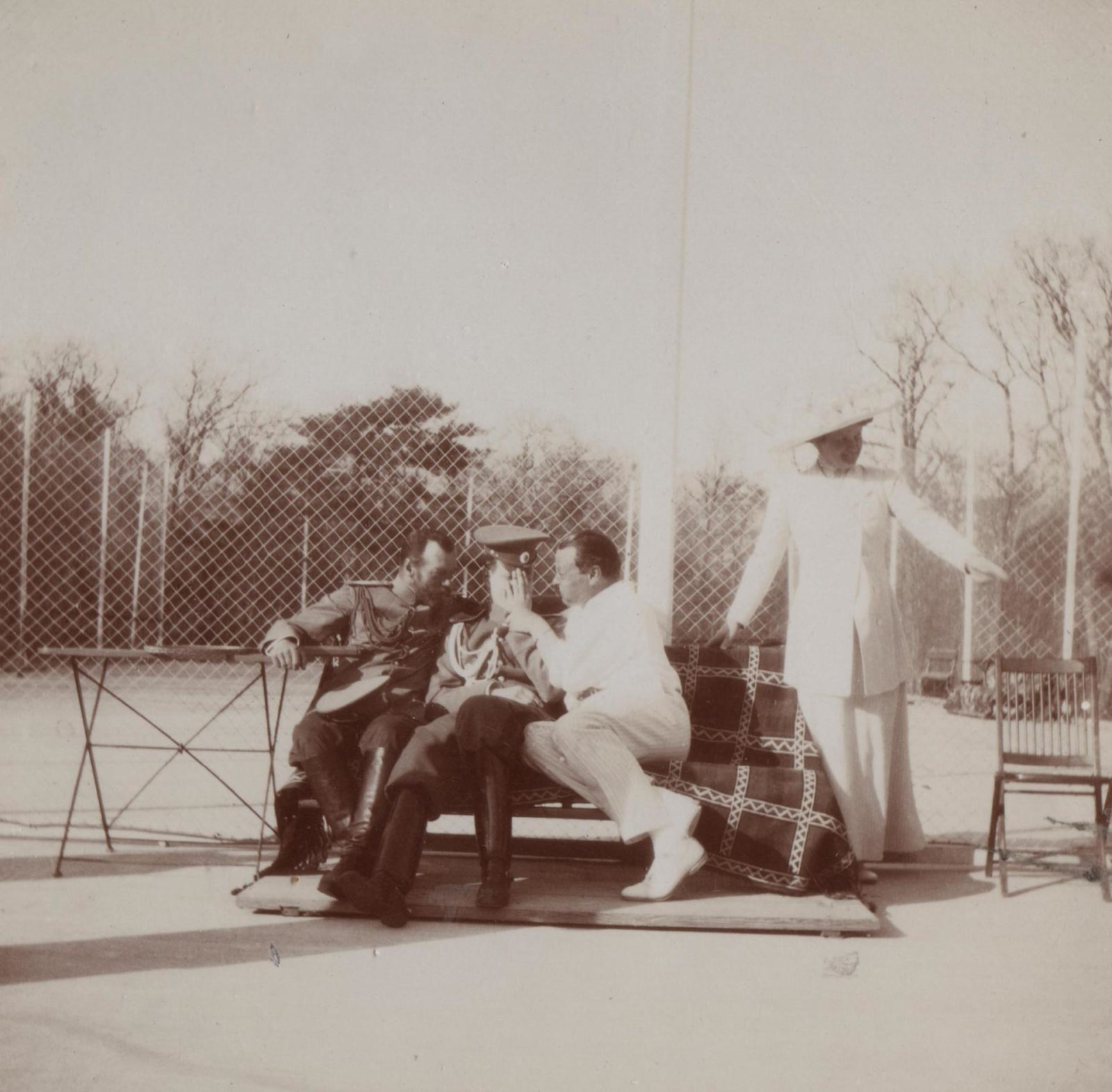 His Imperial Majesty the Emperor Nicholas Alexandrovich (Nicholas II) (left) at the tennis court.