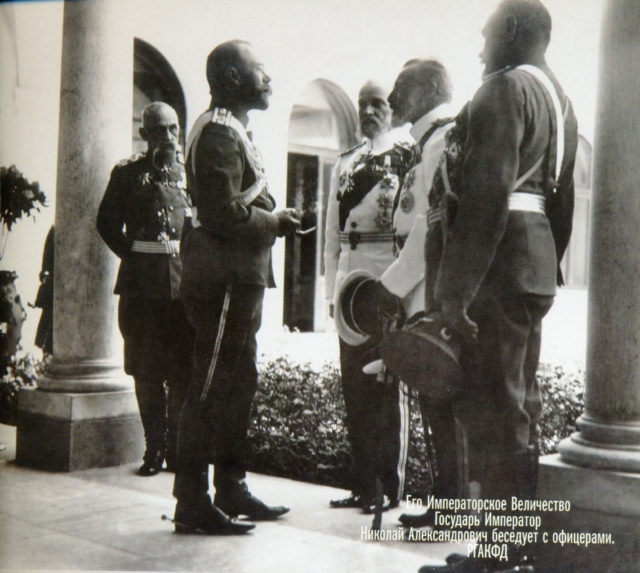 His Imperial Majesty the Emperor Nicholas II talks with the officers.