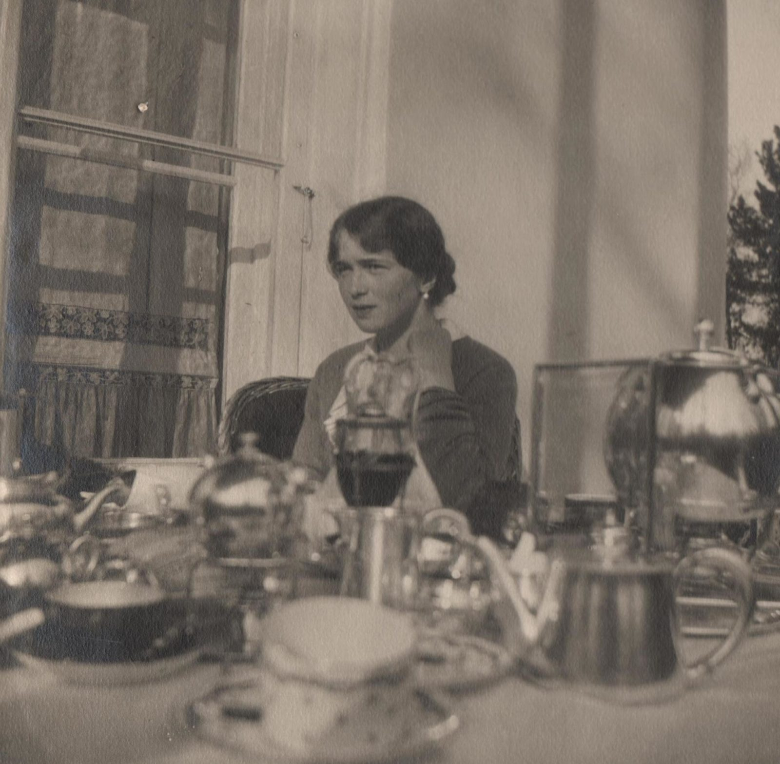The Grand Duchess Olga Nikolaevna during a tea party.