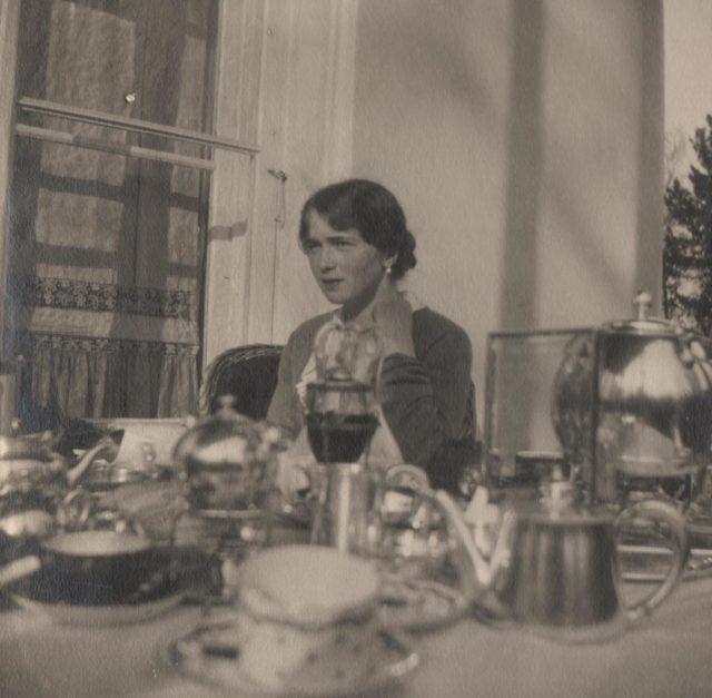 The Grand Duchess Olga Nikolaevna during a tea party.
