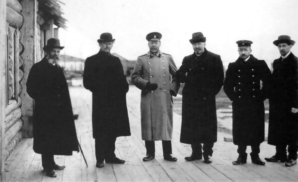 Arkhangelsk photographers Yakov Leitzinger (1st from left), Andrei Karetnikov (5th from left) and Alvian Poplavsky (far left) near the house of Peter the Great.