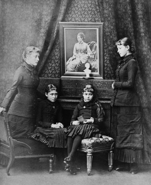 Hessian Princess Victoria, Irena, Alice (Alix) and Elizabeth (Ella) at the portrait of the deceased mother. 1879 year.