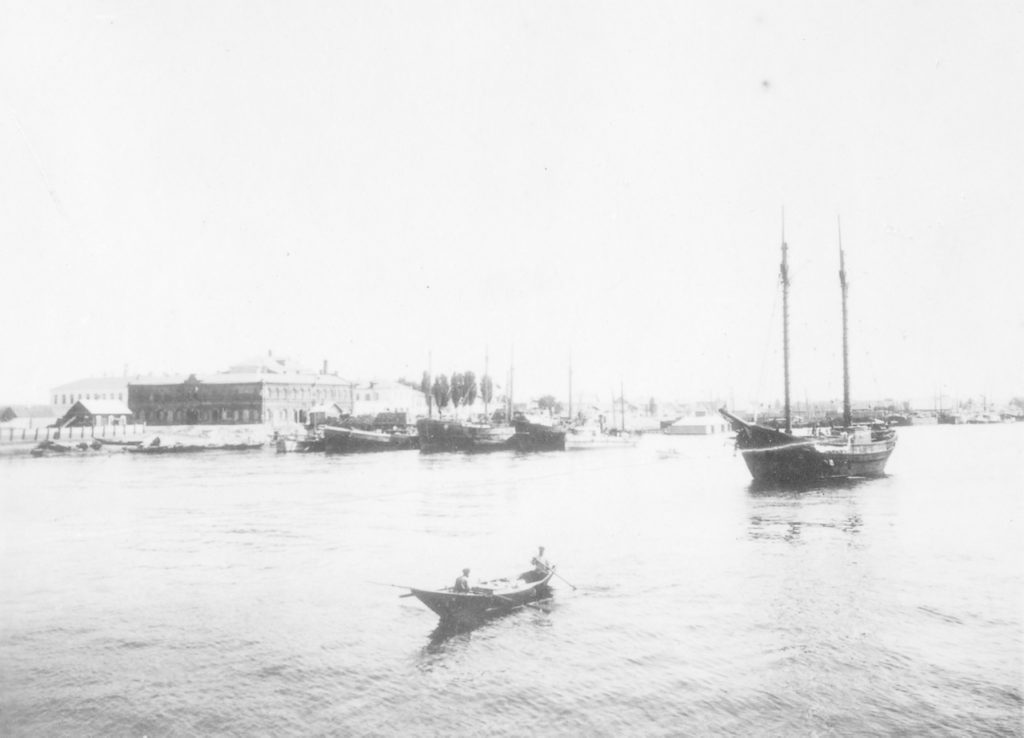 Astrakhan harbor, sailing ship and a row boat