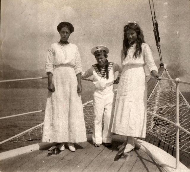Her Highness Grand Duchess Olga Alexandrovna with nephews Tsarevich Alexei Nikolayevich and Grand Duchess Maria Nikolaevna.