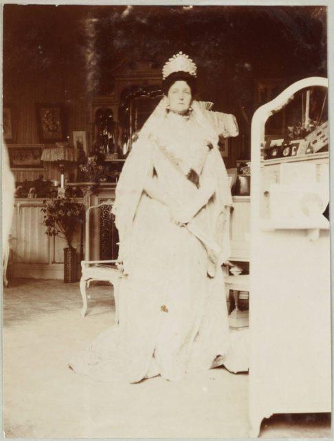 Russian Empress Alexandra Feodorovna in a dress and a large diamond tiara.