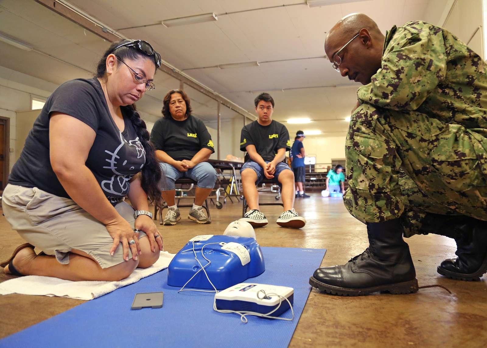 A Lanai community member and U.S. Navy Hospital Corpsman