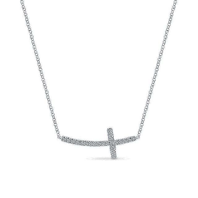 Curving Sideways Cross Encrusted In Pave Diamonds in 14k