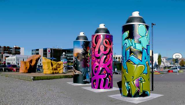 Giant spray cans.