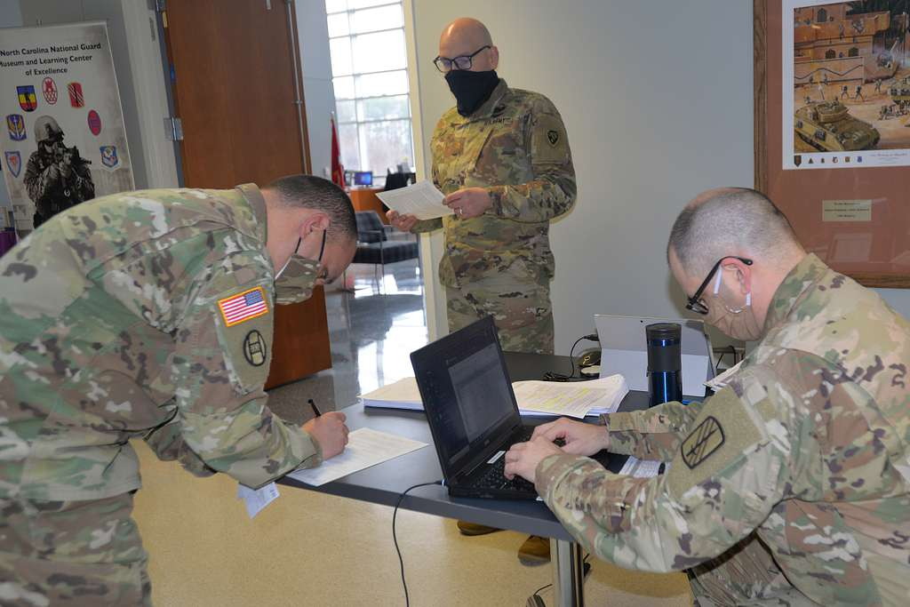 Army 2nd Lt. Andrew Bourgeois, right, assigned to the