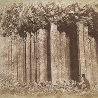 Staffa near Fingal's Cave (seated figure who might be John Muir Wood)
