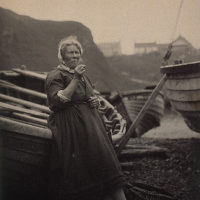 'At Auchmithie 1881'. Woman leaning against boat