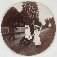 Children walking with a wheelbarrow
