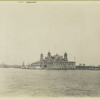 A view of Ellis Island taken from the harbor. At the center ...