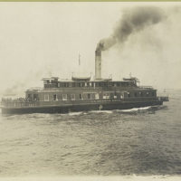 Ferry boat, the Ellis Island, which is also marked Departmen...