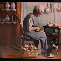 Genre scene, woman in kitchen peeling vegetables
