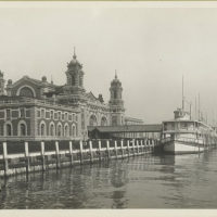 Immigrant Station, Ellis Island, with ferry docked at adjace...