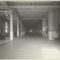View of a long corridor within one of the Ellis Island build...