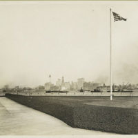 View of the New York skyline from Ellis Island. The Woolwort...