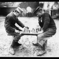 Be careful (the man on the left made this board and chessmen himself)