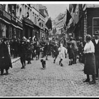 Canadians marching through the streets of Mons, on the morning of November 11th 1918