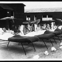Five soldiers recuperating in the sun, during World War I