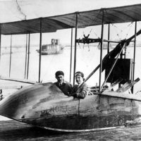 "Men sitting in the flying boat ""Benoist"": Saint Petersburg, Florida"