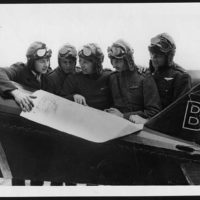 Pilots in a R.A.F. squadron: an American, Canadian, New Zealander, Englishman and South African