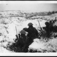 Scene in a trench where bombs take the place of snowballs