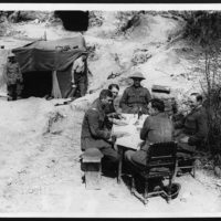 Though near the line the M.O.'s of a Dressing Station still have their table, chairs and white tablecloth
