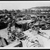 War torn cars at a depot awaiting repair