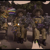 Three boys in western costumes holding flowers