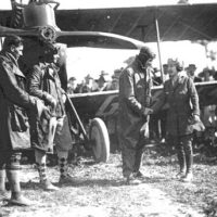 Mabel Cody shaking the hand of another aviator: Coral Gables, Florida