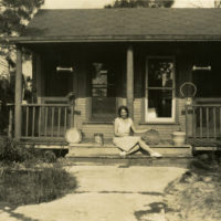 Paula Manley with baskets at cottage