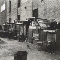 Huts and unemployed, West Houston and Mercer St., Manhattan.
