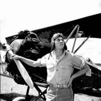 Bill Tankersley from the NYA's Camp Roosevelt posing in front of an airplane: Ocala, Florida