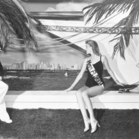 Mitzi Strother, Miss Florida 1941, posing with a seaside backdrop