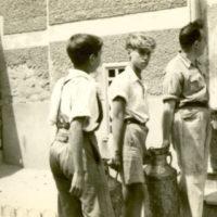 Boys Carrying Jugs
