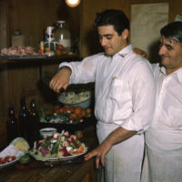 Louis and Michael Pappas preparing Greek salad at Riverside Cafe in Tarpon Springs, Florida