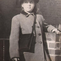 Irma Ruby wearing WAVE hat and holding Navy Purse (10 years old)