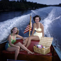 Lois Duncan Steinmetz (left) and Polly Gaines in a motorboat: Sarasota, Florida