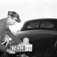 Unidentified Man Changing His Automobile License Plates